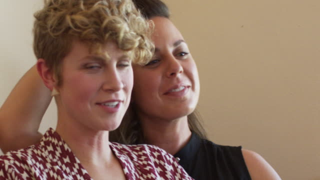 portrait of a married young lesbian couple - nose piercing stock videos & royalty-free footage