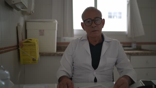 portrait of a mature doctor working - polio stock videos & royalty-free footage