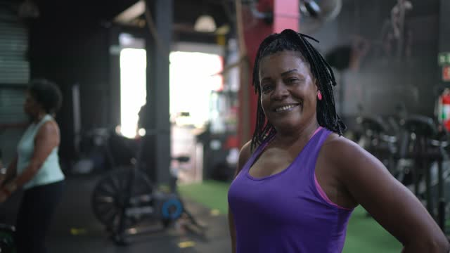 portrait of a mature woman in a gym - braided hair stock videos & royalty-free footage