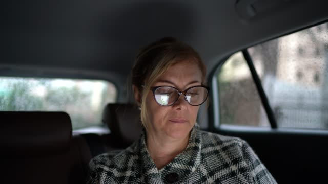portrait of a mature woman inside a cab - waiting stock videos & royalty-free footage