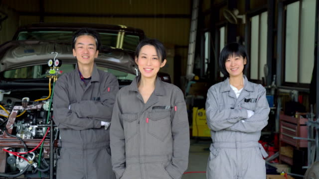 portrait of a mechanic team - east asian culture stock videos & royalty-free footage