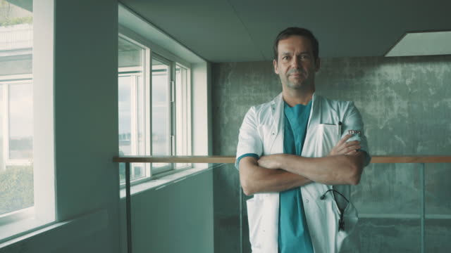 portrait of a medical professional - positive emotion stock videos & royalty-free footage