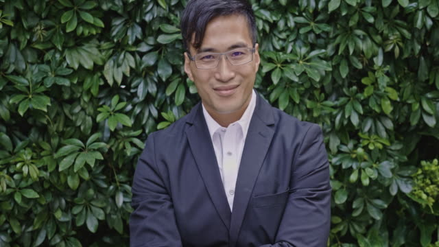 portrait of a mid adult chinese businessman - handsome people stock videos & royalty-free footage
