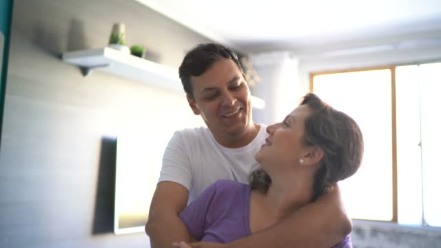 portrait of a mid adult couple at home - mid adult couple stock videos & royalty-free footage