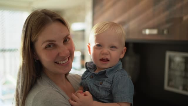 portrait of a mother holding her son at home - baby boys stock videos & royalty-free footage