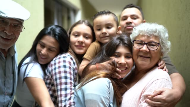 portrait of a multi generation family embracing at home - mixed age range stock videos & royalty-free footage