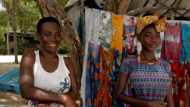 vídeos y material grabado en eventos de stock de portrait of a particularly attractive african-caribbean girl with her mother - antillas occidentales