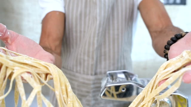 portrait of a pasta maker - tagliatelle stock videos and b-roll footage