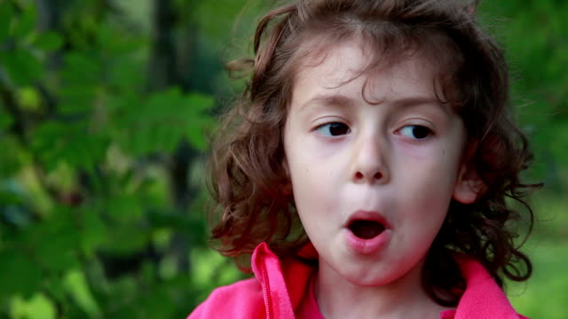 portrait of a playful little girl opening mouth like a fish - imitation stock videos & royalty-free footage