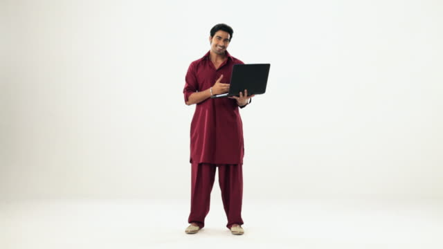 portrait of a punjabi man working on a laptop  - full length stock videos & royalty-free footage