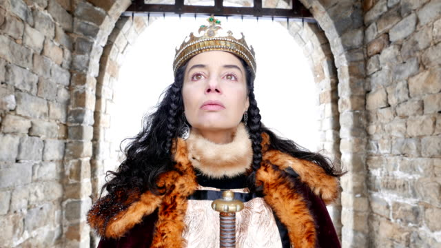 4k portrait of a queen in front of her castle - crown headwear stock videos & royalty-free footage
