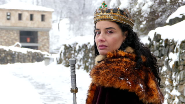 4k portrait of a queen in front of her castle - medieval stock videos & royalty-free footage