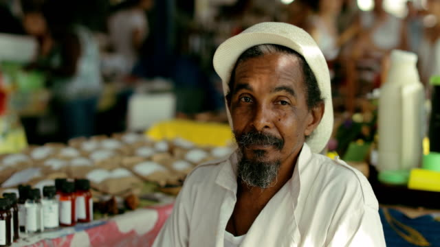 portrait of a rastafarian at a local market in martinique - rastafarian stock videos & royalty-free footage