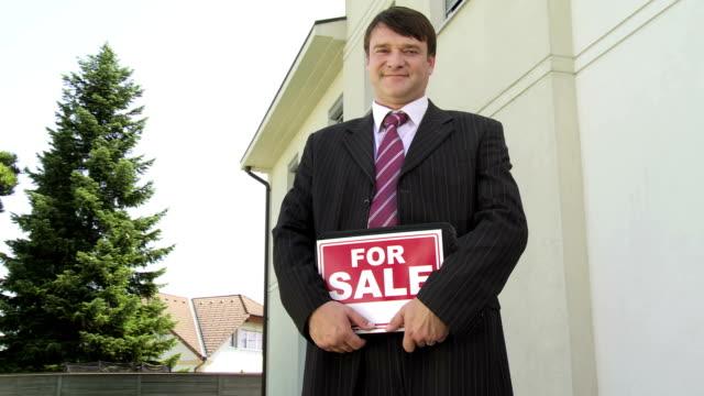 hd dolly: portrait of a realtor - estate agent sign stock videos & royalty-free footage