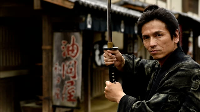 portrait of a ronin samurai with his blade drawn - samurai stock videos & royalty-free footage