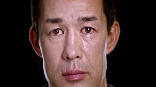 Portrait of a sad Asian man