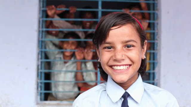 vídeos de stock e filmes b-roll de portrait of a school girl smiling, faridabad, haryana, india  - educação