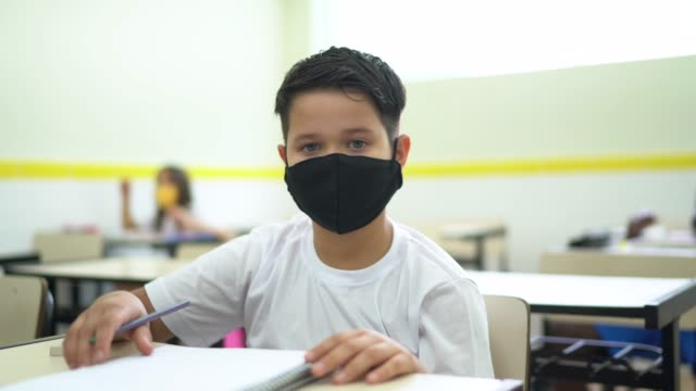 portrait of a schoolboy studying in the classroom - prevention stock videos & royalty-free footage