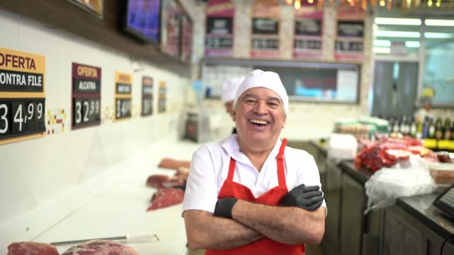 portrait of a senior butcher in a butchers shop - food and drink industry stock videos & royalty-free footage