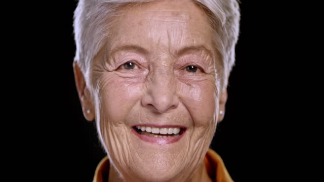portrait of a senior caucasian woman smiling - senior women stock videos & royalty-free footage