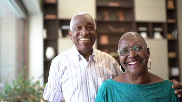 portrait of a senior couple at home - home interior stock videos & royalty-free footage