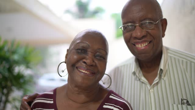 portrait of a senior couple at home - completely bald stock videos & royalty-free footage