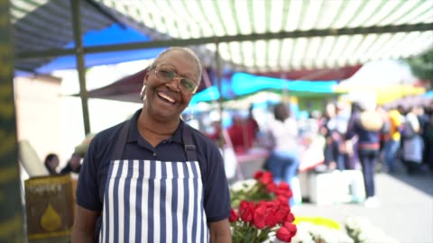 portrait of a senior florist working in a street market - vendor stock videos & royalty-free footage