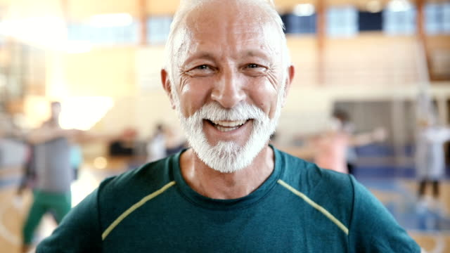 portrait of a senior man at dance class in slow motion - terza età video stock e b–roll