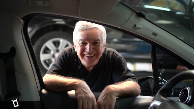 portrait of a senior man in the car - selling stock videos & royalty-free footage