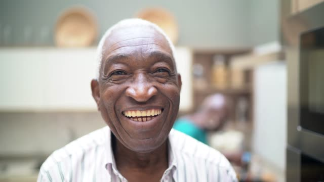 portrait of a senior man looking at camera - happy human face stock videos & royalty-free footage