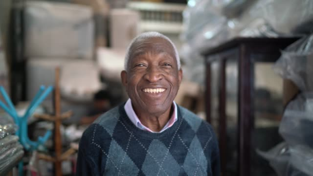 portrait of a senior man standing in an upholstery workshop - pardo brazilian stock videos & royalty-free footage