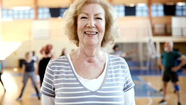 Portrait of a senior woman at dance class in slow motion