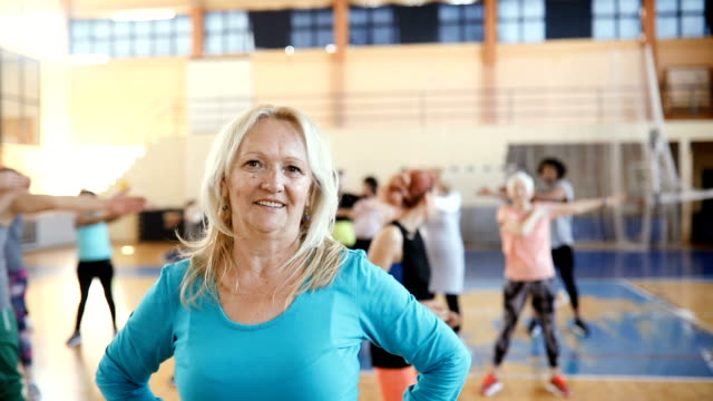 portrait of a senior woman at dance class in slow motion - body positive stock videos & royalty-free footage