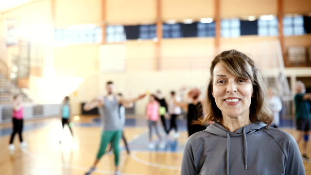 portrait of a senior woman at dance class in slow motion - fitness instructor stock videos & royalty-free footage