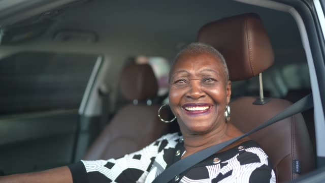 portrait of a senior woman driving a car - balding stock videos & royalty-free footage
