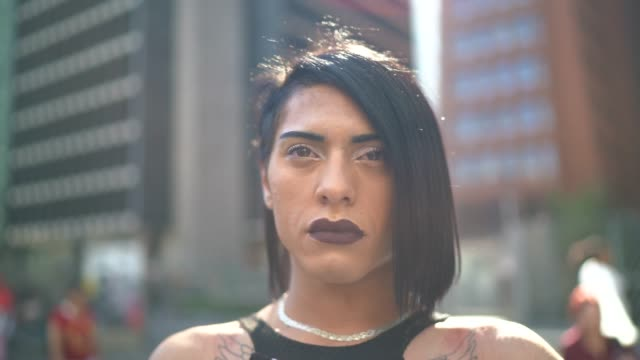 portrait of a serious transgender woman during lgbtqi parade - respect stock videos and b-roll footage