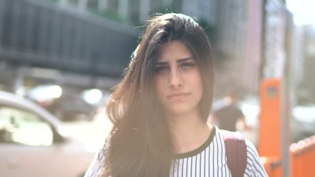 portrait of a serious young woman - standing out from the crowd stock videos & royalty-free footage