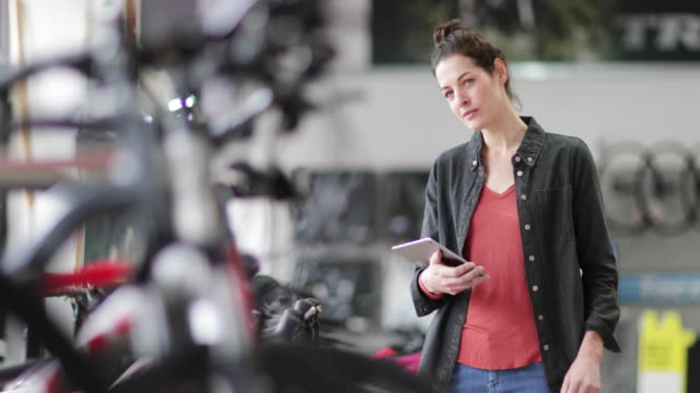 portrait of a small business owner in a bike store - counting stock videos & royalty-free footage