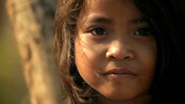 portrait of a small cambodian girl - poverty stock videos & royalty-free footage