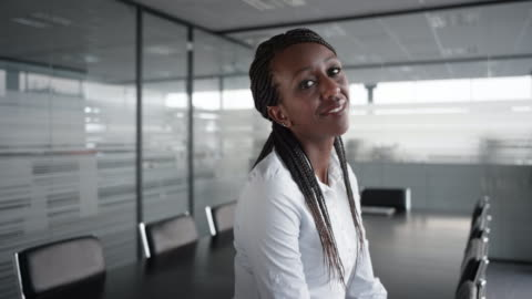 portrait of a smiling african-american businesswoman in an empty conference room - businesswear stock videos & royalty-free footage