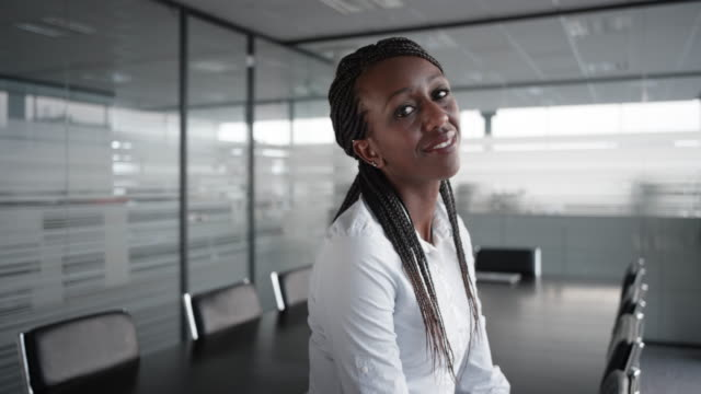 portrait of a smiling african-american businesswoman in an empty conference room - business finance and industry stock videos & royalty-free footage