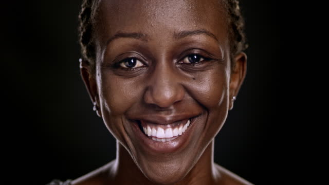 portrait of a smiling african-american woman - front view stock videos & royalty-free footage