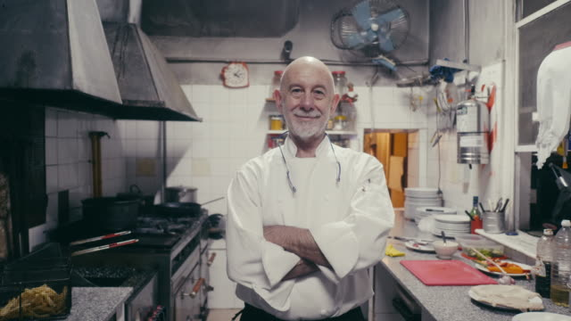 portrait of a smiling argentinian chef in his kitchen - catering occupation stock videos & royalty-free footage