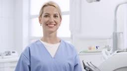 Portrait of a smiling Caucasian oral hygienist