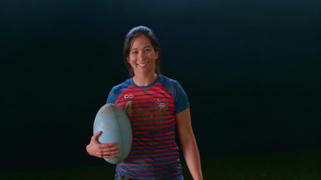 slo mo portrait of a smiling female rugby player holding a ball - rugby stock videos & royalty-free footage