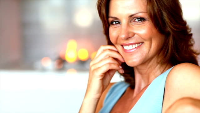 portrait of a smiling mature lady at home - 40 44 years stock videos & royalty-free footage