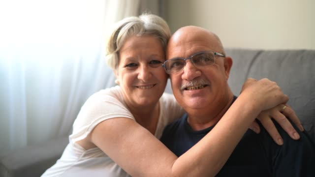 portrait of a smiling senior couple at home - 60 64 years stock videos & royalty-free footage