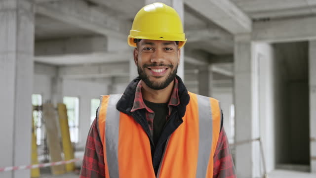portrait of a smiling young male construction worker - construction worker stock videos & royalty-free footage