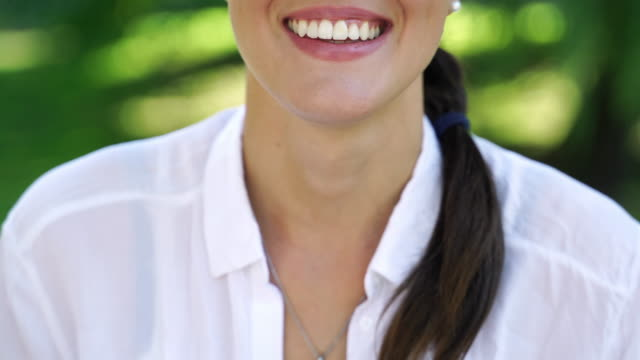 portrait of a smiling young woman sticking out tongue - lingua umana video stock e b–roll