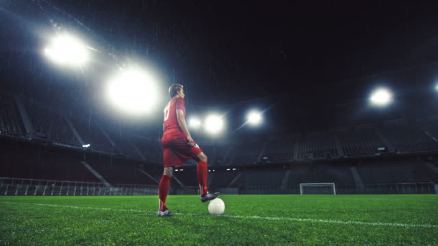 ds portrait of a soccer player in an empty stadium - football player stock videos & royalty-free footage